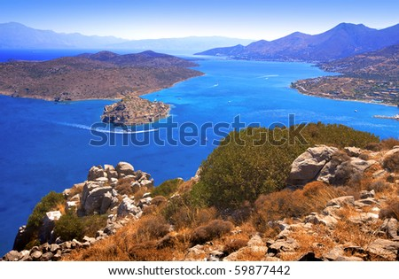 The island of Spinalonga (official name: Kalidon) is located at the eastern section of Crete, in Lasithi prefecture, near the town of Elounda. Mirabello Bay. - stock photo