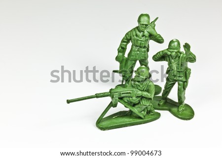The isolated image of the plastic toy soldiers - stock photo