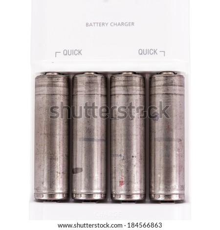 the isolated of the AA battery with charger is energy refill on white background - stock photo