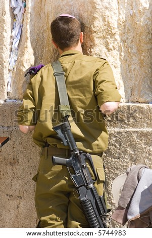 The Israeli soldier prays at the Wailing Wall. Jerusalem, Israel - stock photo