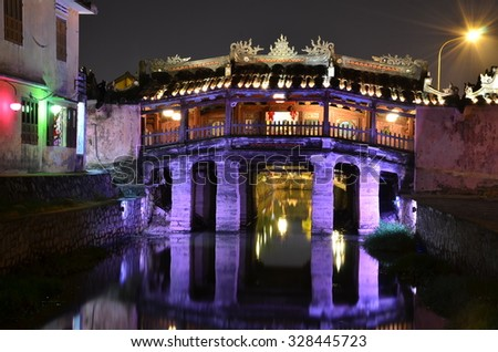 The Japanese coverage bridge at night - Hoi An Vietnam. This bridge connected the Japanese section of the old town of Hoi An and was built in 1590. - stock photo