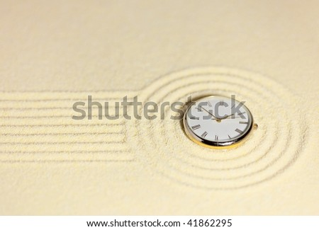 The Japanese rock-garden in a miniature with watch close up - stock photo