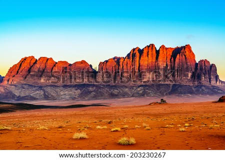 The Jebel Qatar Mountain in Wadi Rum, Jordan at twilight. Wadi Rum is known as The Valley of the Moon and a UNESCO World Heritage Site. - stock photo