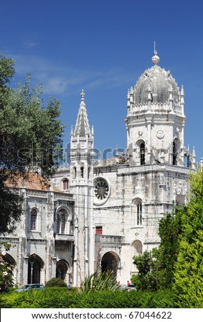 The Jeronimos Monastery is one of the most prominent monuments of Lisbon. Shooted from the park in front of the monument. - stock photo