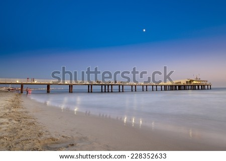 The jetty of Lido di Camaiore in the evening, Tuscany, Italy.  - stock photo