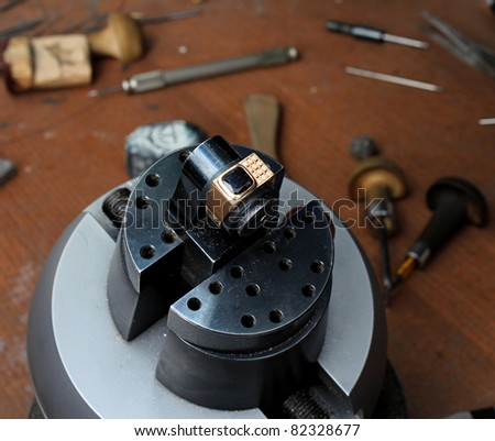 The jeweller is working at jeweller's workshop - stock photo
