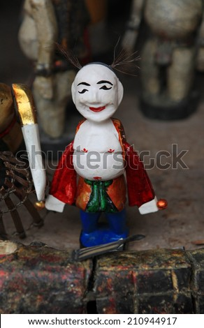 The Joker (Chu Teu in Vietnamese) - one of the most well known character of the traditional water puppets performance shows at  a theater in Hanoi, Vietnam - stock photo