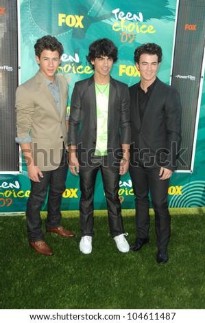 The Jonas Brothers at the Teen Choice Awards 2009. Gibson Amphitheatre, Universal City, CA. 08-09-09 - stock photo