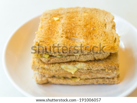 The kaya toasts on the white dish and table in Singapore - stock photo