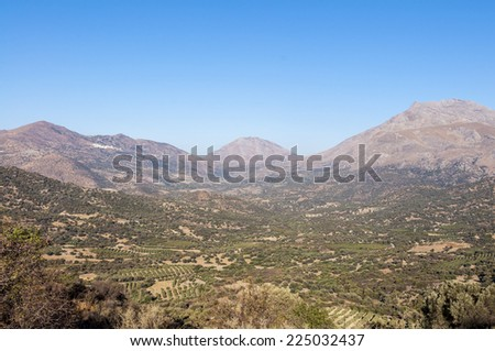 The Kedros Mountain on Crete. On the old road to Rethymnon. Landscape, Mountain and Olive Groves in south Crete. On the left side in the mountains the village Melambes - stock photo