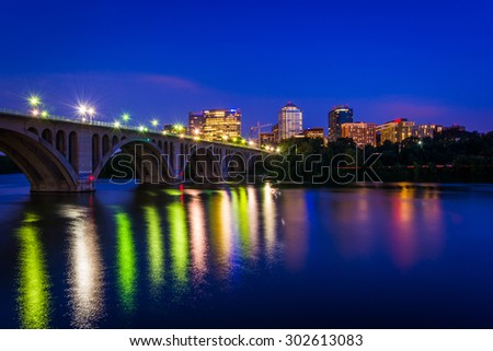 The Key Bridge over the Potomac River and Rosslyn skyline at night, seen from Georgetown, Washington, DC. - stock photo