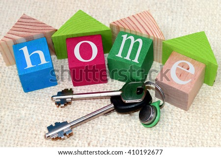 The keys to the apartment and wooden blocks - stock photo