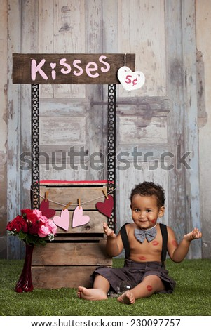 The kissing booth.  Adorable toddler running a kissing booth.   - stock photo