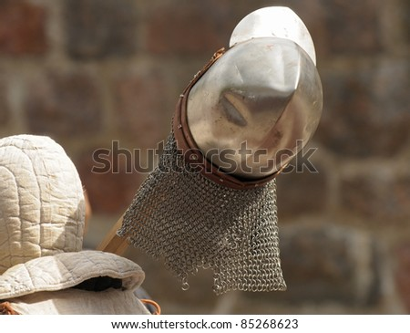 The knight bears a helmet on a staff of a spear - stock photo