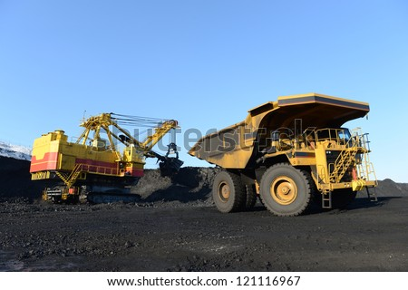 the kovshovy excavator, the dump heavy-load truck, the truck - stock photo