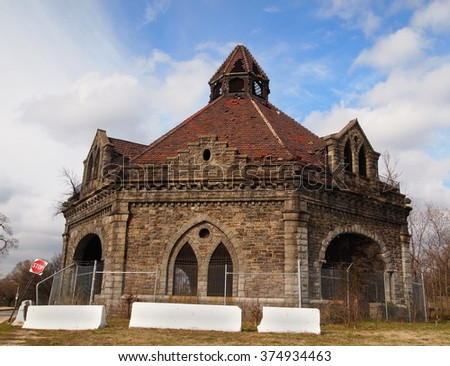 The Lake Clifton Valve House, also known as the Clifton Park Gate House, built in 1887, stands somewhat in ruins and decay, but is protected by the National Register of Historic Places.  - stock photo