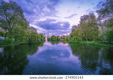 The lake in St James park, London, with the big wheel in the background - stock photo