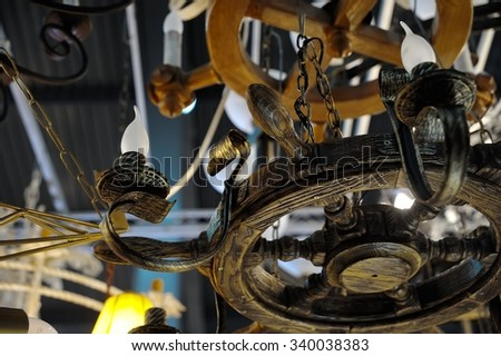 The lamp in the form of marine helm - stock photo