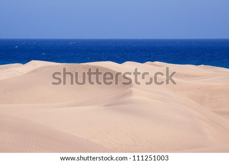 The landmark dunes of Maspalomas in Gran Canaria, one of the Canary Islands, Spain - stock photo
