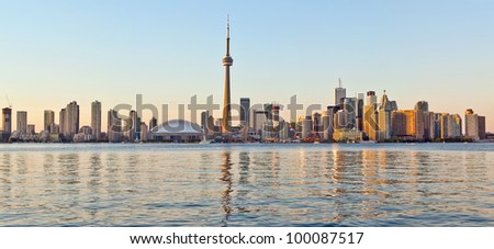 The landmark Toronto downtown view from the center island. Scenic view of the Tower illuminated by the iconic downtown skyline of skyscrapers and high rise condominiums reflecting in Lake Ontario - stock photo