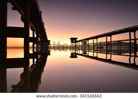 The landscape of concrete bridge For pumping station reservoir area Background sunrise - stock photo