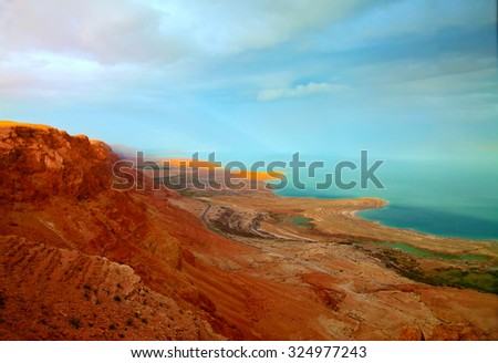The landscape of the Dead Sea shoreline at sunset (sunset lighting, toned image) - stock photo