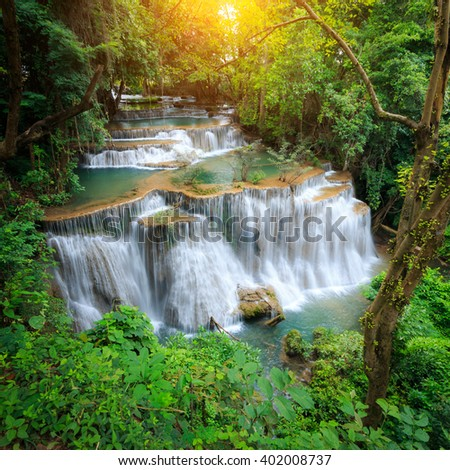 The landscape photo, Huay Mae Kamin Waterfall, beautiful waterfall in rain forest, Kanchanaburi province, Thailand - stock photo