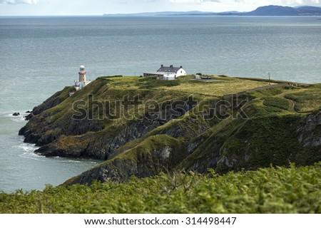 The landscape with coastline and a lighthouse of Howth Head, Ireland - stock photo