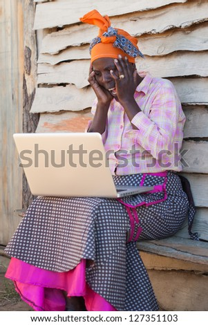 The laptop reveals very shocking information to the people. - stock photo