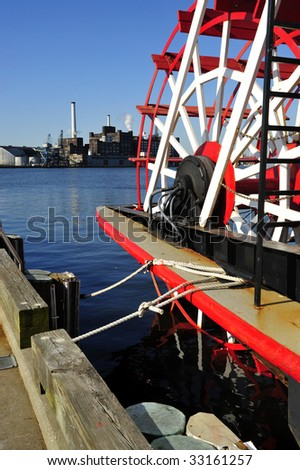 The large paddles of a stearn-wheeled paddle boat that offers cruises of the Inner Harbor, Baltimore, MD - stock photo