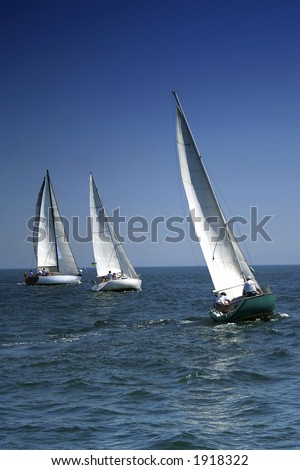 The large race began! Start of a sailing regatta. The sailing yachts compete in speed. - stock photo