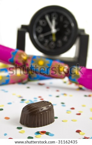 the last filled chocolate before the new year, symbolizing dieting plan for the new year, shallow DOF - stock photo