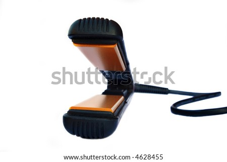 The latest must have ceramic straightening irons for a good Hair Day - stock photo