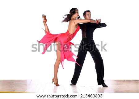 The Latino dancers in ballroom - stock photo