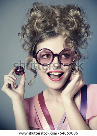 The laughing beautiful girl in pink glasses, a retro style - stock photo