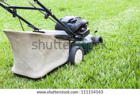 The Lawn mower in the yard - stock photo
