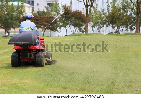 The lawnmower at work - stock photo