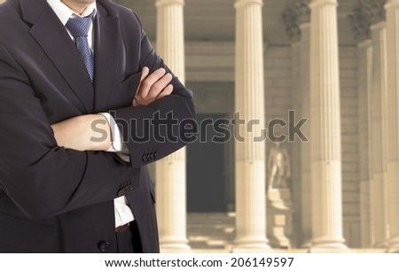 The lawyer is on against the courthouse - stock photo