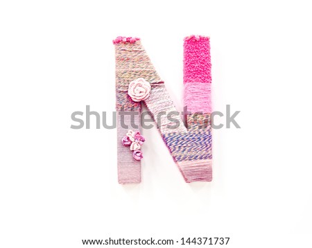 the letter a created with brightly colored knitting yard - stock photo