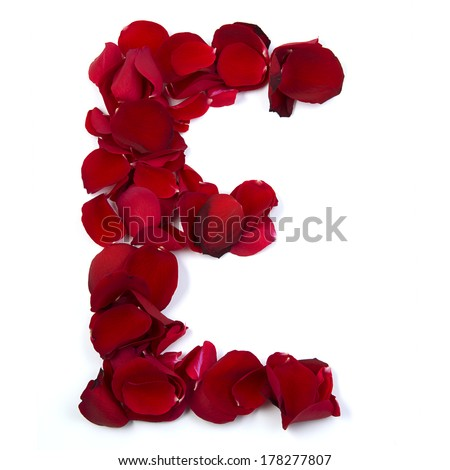 The letter E ending love is written with rose petals. White background. - stock photo