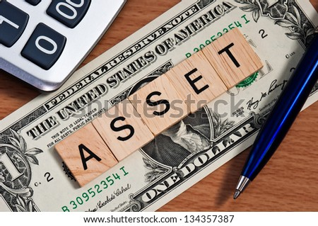 The letters ASSET on  dollar banknote business concept - stock photo