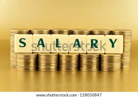 The letters  SALARY with stacks of coins on gold background - stock photo