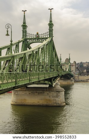 The Liberty Bridge (Freedom Bridge) in Budapest, Hungary, connects Buda and Pest across the River Danube. - stock photo