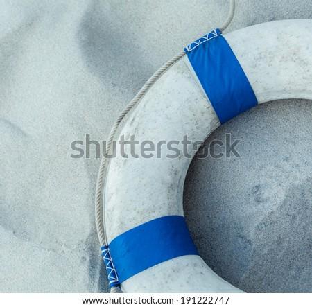 The Life preserver put on the beach. - stock photo