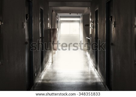 The light from the window of an old hotel corridor. - stock photo
