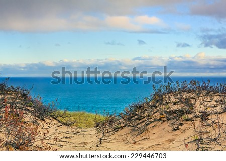 The light of early morning illumines the landscape of Grand Sable Dunes and Lake Superior at Upper Peninsula Michigan's Pictured Rocks National Lakeshore. - stock photo
