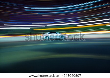 the light trails of city traffic on the modern building background. - stock photo