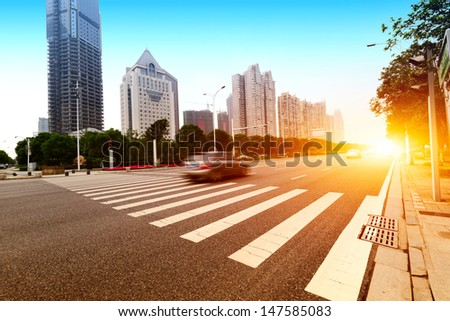 the light trails on the modern building background - stock photo