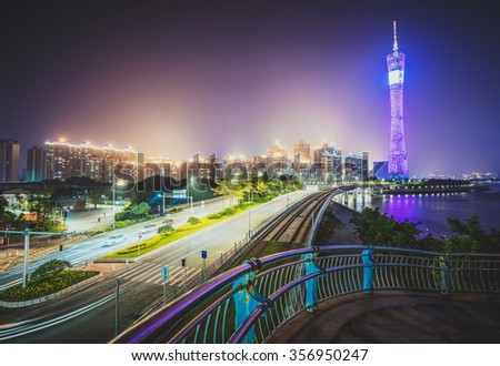 the light trails on the modern building background in guangzhou china. - stock photo