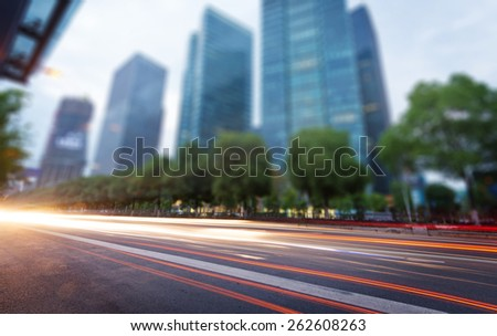the light trails on the modern building background in hangzhou china.  - stock photo